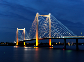 Evening shots of Benton Franklin intercounty bridge lit up over the Columbia River in Kennewick Washington.