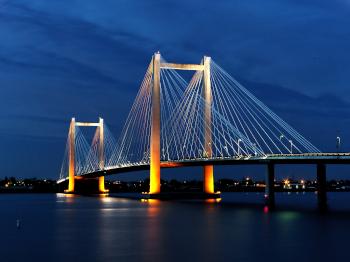 Evening shots of Benton Franklin intercounty bridge lit up over the Columbia River in Kennewick Washington.